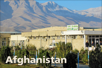 A view of the CURE Kabul hospital in Aghanistan showing the mountains nearby in the background.