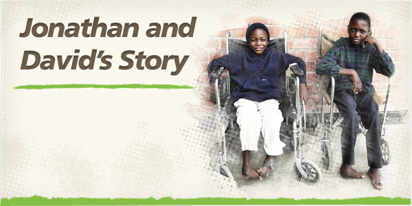 Image of David and Jonathan, two cousins, in wheelchairs before their corrective surgery for clubfoot (background image)