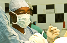 CURE Uganda medical director John Mugamba operating on a patient.